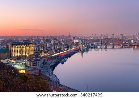 Aerial view of Kyiv with reflection in Dnipro river at dusk. Ukraine