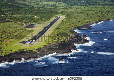 Aerial view of landing airstrip on coast of Maui, Hawaii. - stock photo