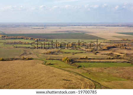 Aerial view of landscape of vast plains and forest in Siberia, Russian Federation. - stock photo