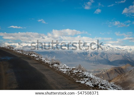 Aerial view of Le-h City, landscape with ice peaks , blue sky in background , Ladak-h, Jam-mu and Kashmir, India