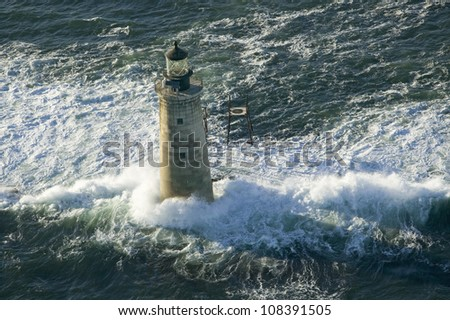 Aerial view of lighthouse at sea on Maine coastline, south of Portland - stock photo