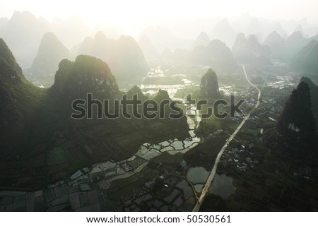Aerial view of limestone formations in Yangshuo, China - stock photo
