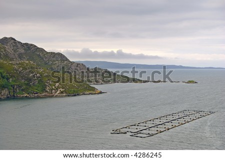 Aerial view of Loch Diabaig, Torridon, NW Scotland with a rocky shore and Salmon farm