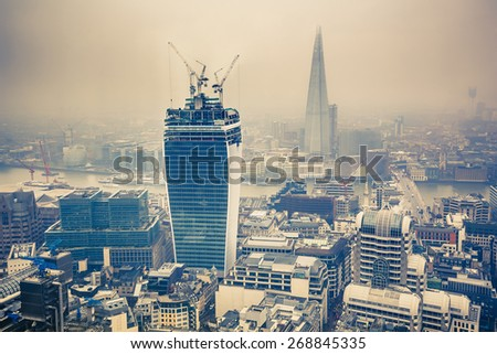 Aerial view of London at rainy day - stock photo