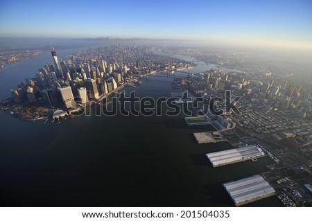 Aerial view of Lower Manhattan, Brooklyn Bridge, Manhattan Bridge and downtown Brooklyn, Brooklyn, New York - stock photo
