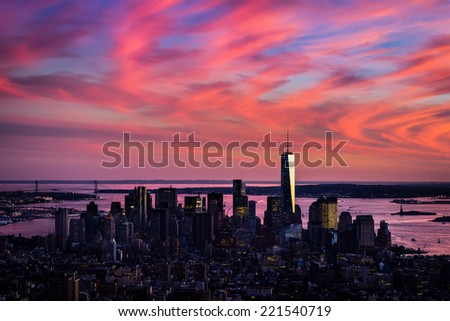 Aerial view of lower Manhattan in wild pink colors of sunset