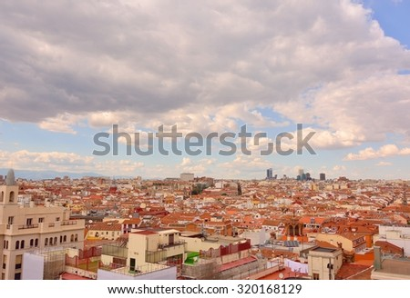 Aerial view of Madrid under a cloudy sky