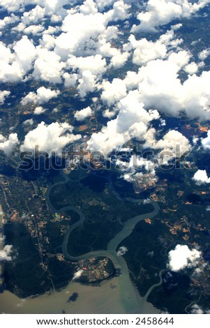Aerial view of mainland over the Indian ocean, taken through an airplane window on a beautiful bright day. - stock photo