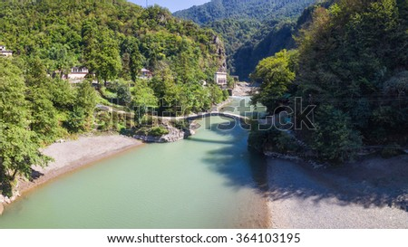 Aerial view of Makhuntseti bridge in Keda District of Ajara in village of Makhuntseti, Georgia. Camera flies on drone above river. - stock photo
