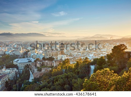 Aerial view of Malaga in sunset lights. Spain - stock photo