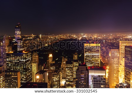 aerial view of Manhattan, New York City, with Central Park at night  - stock photo