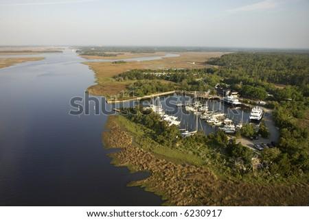 Aerial view of marina in wetlands of Bald Head Island, North Carolina. - stock photo