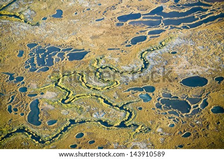 Aerial view of marsh, wetland abstraction of salt and seawater, and Rachel Carson Wildlife Sanctuary in Wells, Maine - stock photo