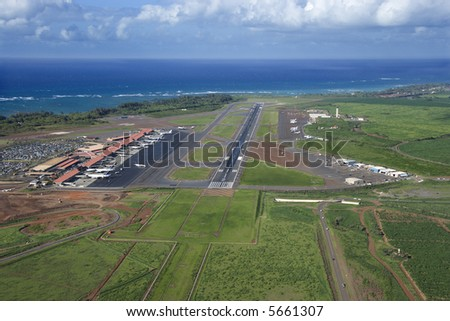 Aerial view of Maui, Hawaii airport with Pacific ocean. - stock photo