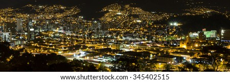 Aerial view of Medellin at night with residential and office buildings. Colombia - stock photo