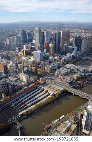 Aerial View of Melbourne City. In the foreground is the Yarra River & Flinders Street Station and in the background the CBD. - stock photo