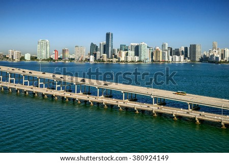 aerial view of miami's brickell avenue skyline and rickenbacker causeway on clear, sunny morning - stock photo