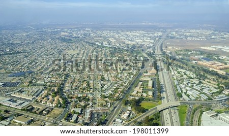 Aerial view of Midway District neighborhood and San Diego International Airport (Lindbergh Field), in Southern California, United States of America. Dominated by multi lane roads with heavy traffic - stock photo