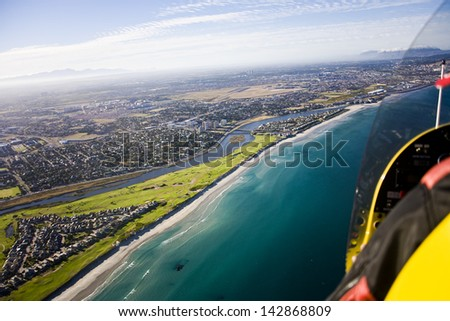 Aerial view of Milnerton Golf Course, Estate, Beach and Lagoon from aircraft, Cape Town, South Africa - stock photo