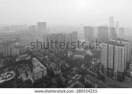 Aerial view of misty skyline cityscape. Concept of city pollution  - stock photo
