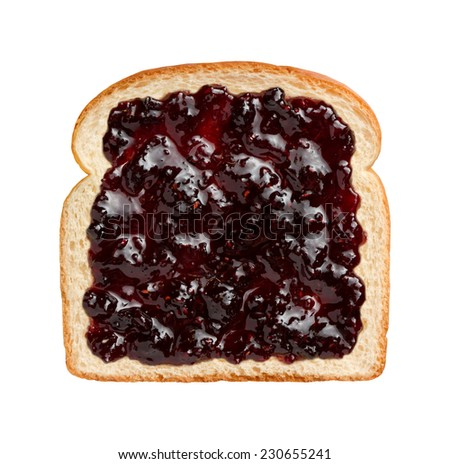 Aerial view of mixed berries preserves, spread over a slice of white bread. This jam contains strawberries, blackberries, raspberries, blueberries.  - stock photo