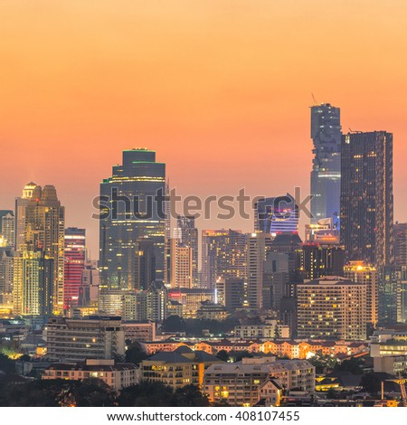 Aerial view of modern office buildings, condominium in big city downtown at sunset - stock photo