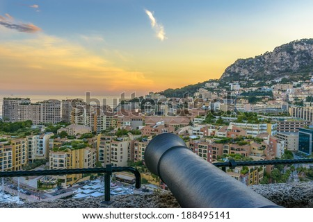 Aerial view of Monaco's harbor with yachts sailing  at sunset - stock photo
