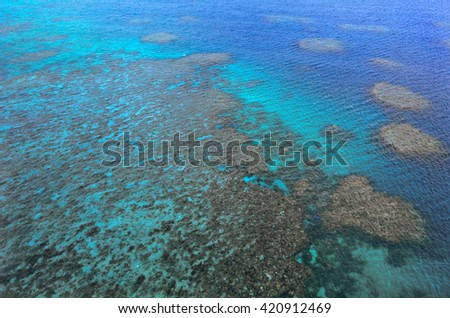 Aerial view of Moore coral reefs at  the Great Barrier Reef near Cairns in Tropical North Queensland, Queensland, Australia.