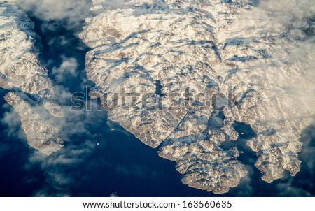 aerial view of mountains and coast of greenland - stock photo