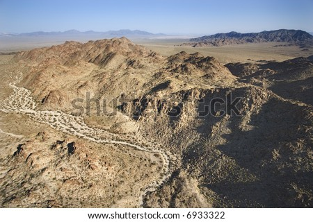 Aerial view of mountains in desert.