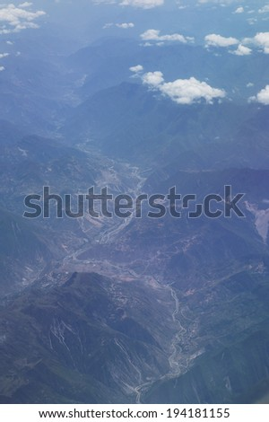 Aerial view of mountains landscape with river - stock photo