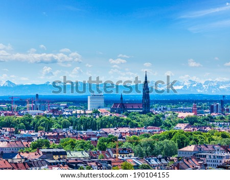 Aerial view of Munich with Bavarian Alps in background, Bavaria, Germany - stock photo