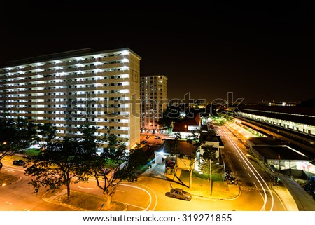 Aerial view of new estate with neighborhood faculties car park and green garden at the center at Eunos area of Singapore. Night view. The Eunos MRT station is on the right - stock photo
