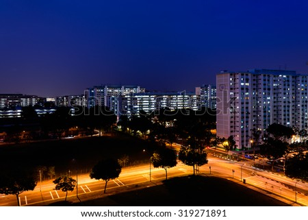 Aerial view of new estate with neighborhood faculties car park and green garden at the center at Eunos area of Singapore. Blue hour view - stock photo