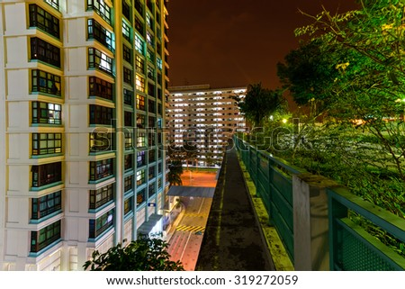 Aerial view of new estate with neighborhood faculties car park and green garden at the center at Eunos area of Singapore. Night view - stock photo