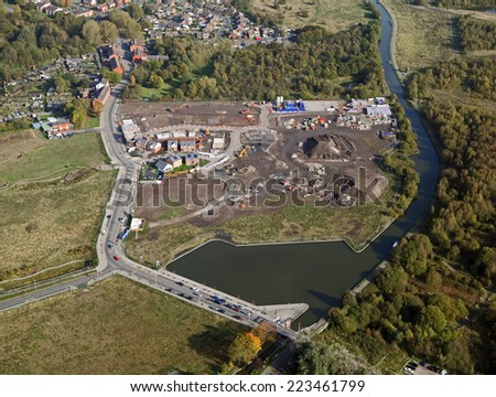 aerial view of new housing being constructed on a brown field site in the UK - stock photo