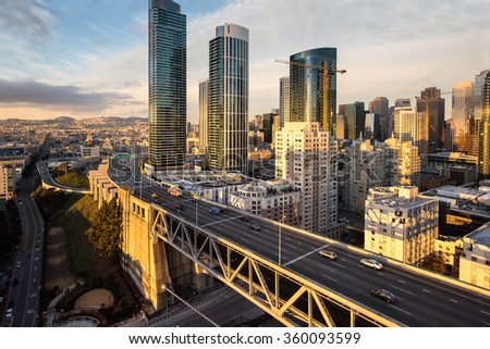 Aerial view of new skyscrapers rising on San Francisco's Rincon Hill with the western approach to the Bay Bridge in the foreground - stock photo