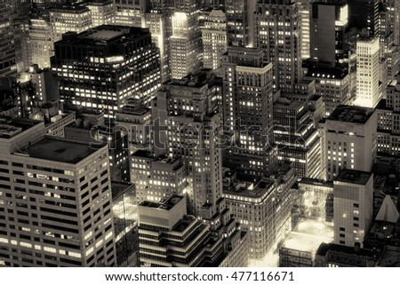Aerial view of New York City buildings illuminated at night
