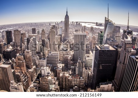 Aerial view of New York city in the USA in the afternoon showcasing its mix of historic and modern buildings. - stock photo