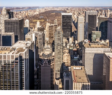 Aerial view of New York city in the USA showcasing the Central Park and its mix of modern and historic skyscrapers.