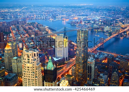 Aerial view of New York City skyline with Three Bridges at dusk - stock photo