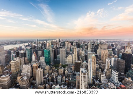 Aerial view of New York City skyline with urban skyscrapers at sunset - stock photo