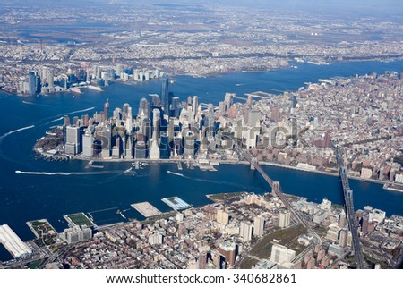Aerial view of New York City with the Hudson River and the East River in Lower Manhattan.