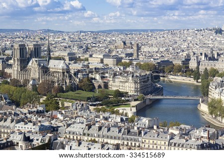 Aerial view of Notre-Dame cathedral and Paris roofs - stock photo