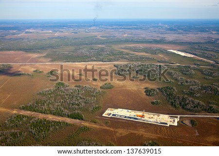 Aerial view of oil rig at an oil field in Western Siberia in the autumn - stock photo