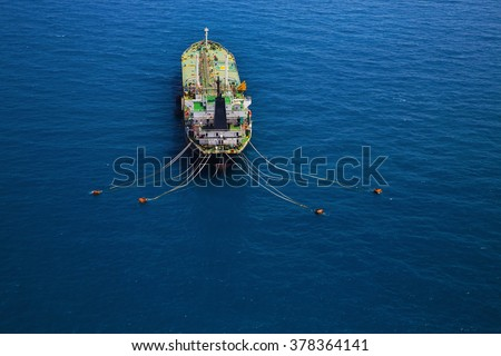 Aerial view of oil tanker ship sailing on open sea - stock photo