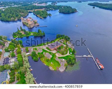 Aerial view of Olavinlinna Olofsborg Medieval 15th century northernmost Stone Castle in Savonlinna, Finland. - stock photo