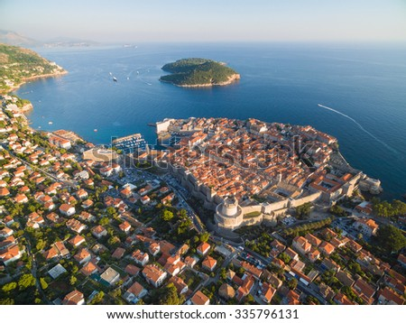Aerial view of old city of Dubrovnik (Croatia), popular tourist attraction on Adriatic. Lokrum island in the background. - stock photo