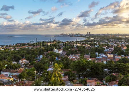 Aerial view of Olinda and Recife in Pernambuco, Brazil at sunset on a sunny summer day. - stock photo