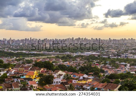 Aerial view of Olinda and Recife in Pernambuco, Brazil showcasing its mix of modern and historic architecture at sunset. - stock photo
